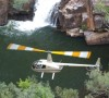 Airborne Solutions helicopter above a waterhole